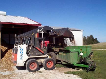 skid loader dumping load