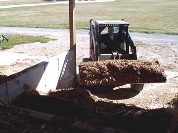 skid loader hauling load